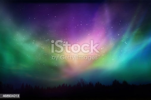 istock Multicolored northern lights (Aurora borealis)on Canadian forest 468904013