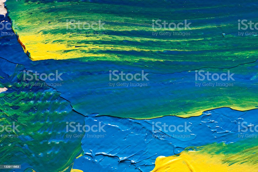 A multicolored oil canvas in yellow, green, and blue royalty-free stock photo