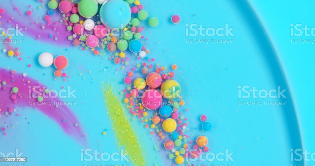 Multicolored paint bubbles stock photo