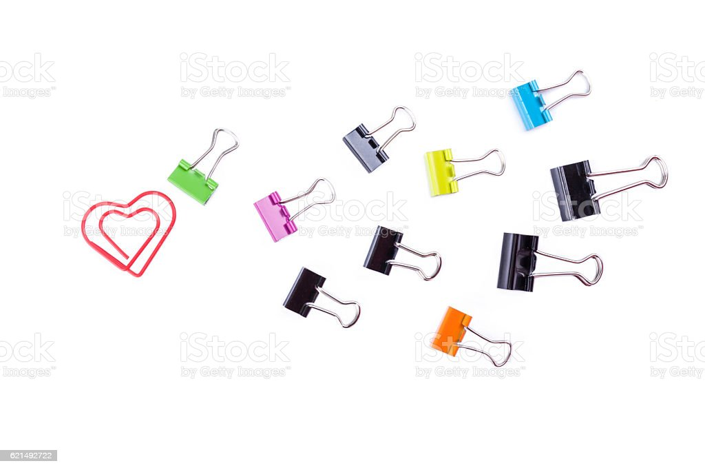 Multicolored paper clip binders and heart paper clip isolated on Lizenzfreies stock-foto