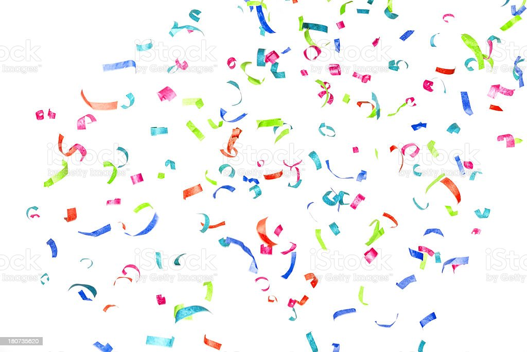 Multicolored paper confetti or streamers falling isolated on white royalty-free stock photo