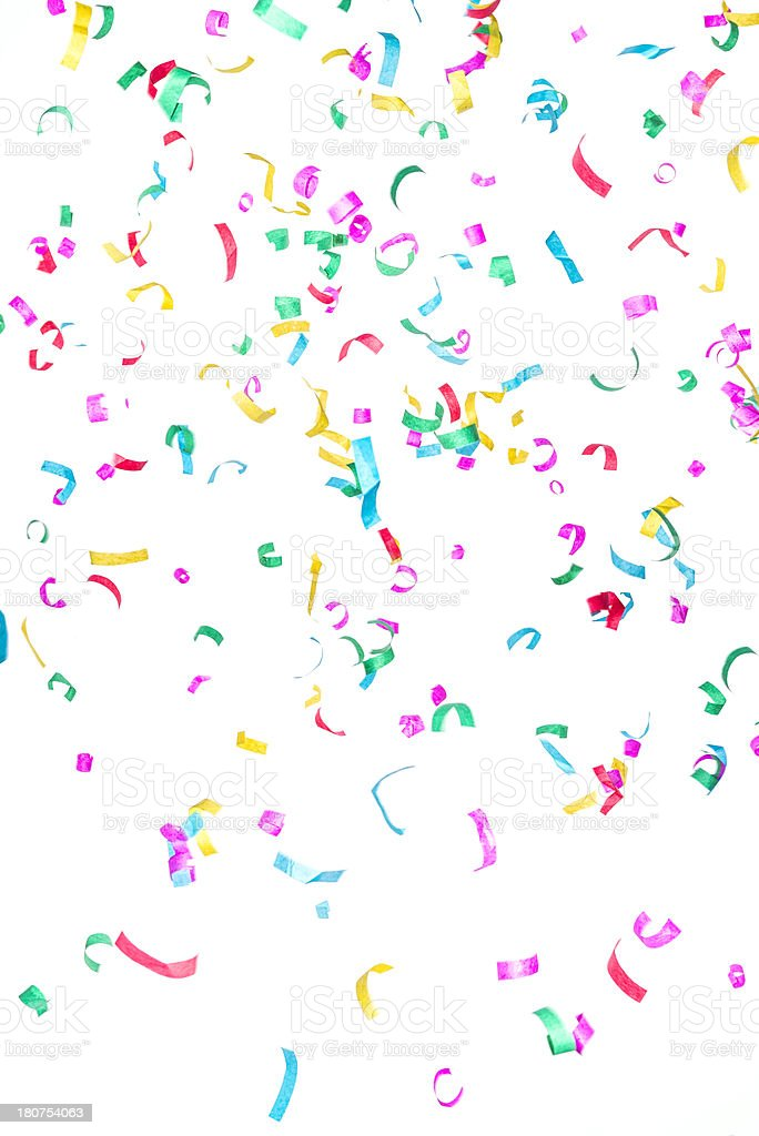 Multicolored paper confetti or streamers falling isolated on white stock photo