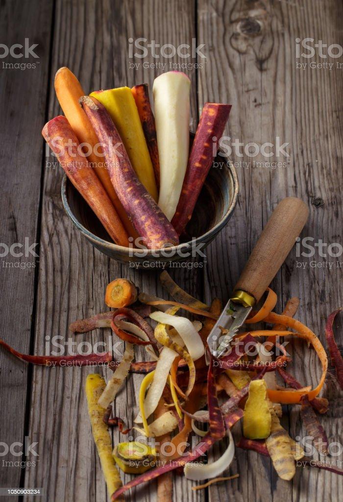 Multicolored peeled carrots стоковое фото