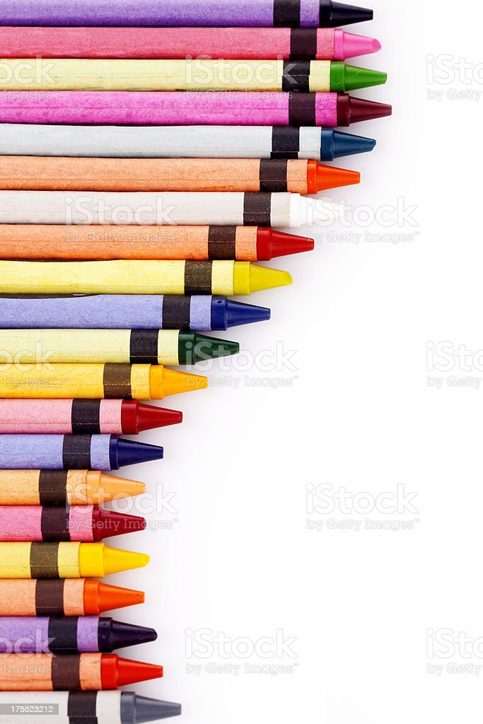 Multi-colored pencil crayons on white background royalty-free stock photo