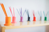 Set of multi-colored  pencils in a row at preschool