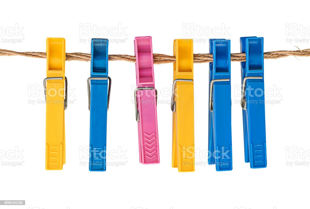 Multicolored plastic clothespins on a rope stock photo