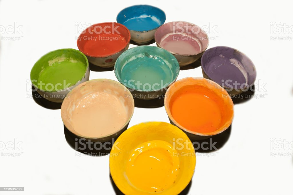 Multicolored plastic cups with paints on white background. stock photo