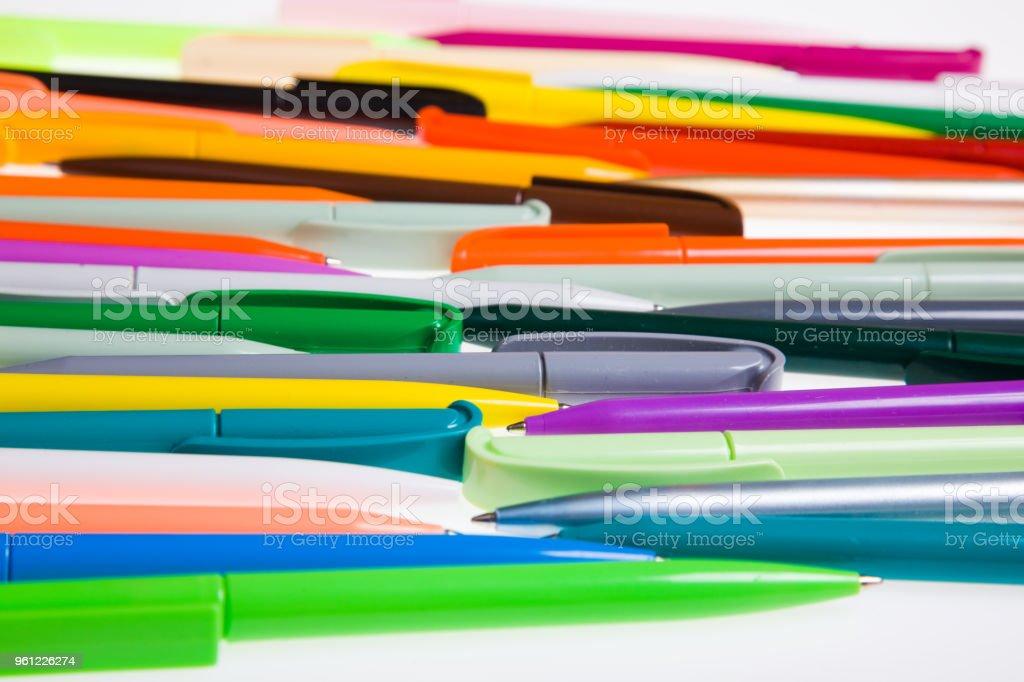 Multi-colored plastic pens. stock photo