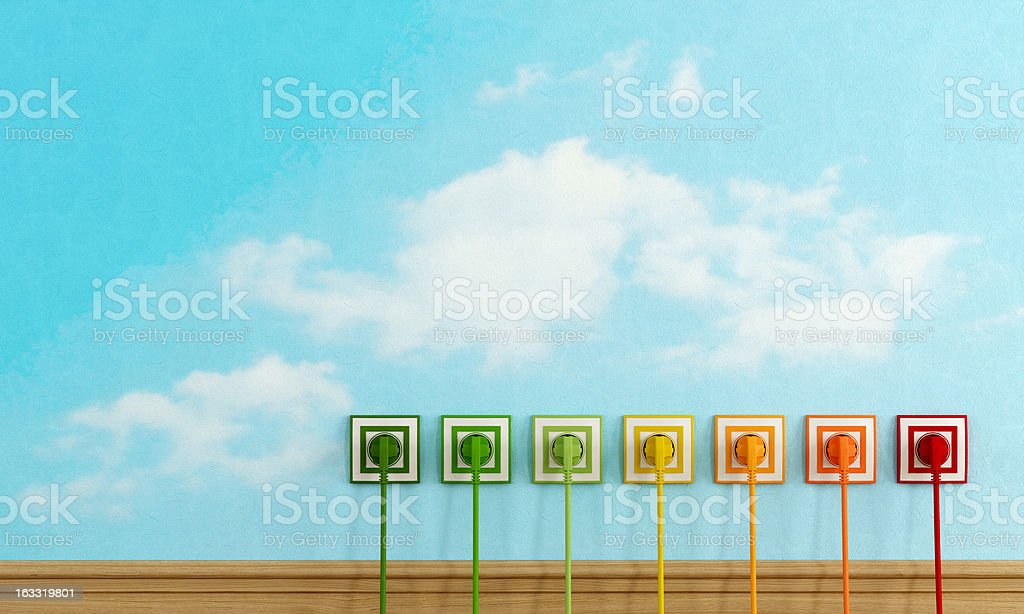 Multicolored plugs in a sky wall stock photo