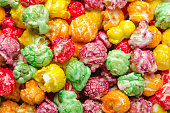 istock Multicolored popcorn scattered on pile. Background, close up 1028847142