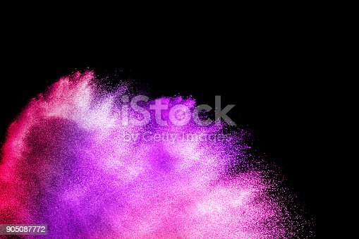 istock Multicolored powder explosion cloud isolated on black background. Freeze motion of color dust  particles splash. 905087772