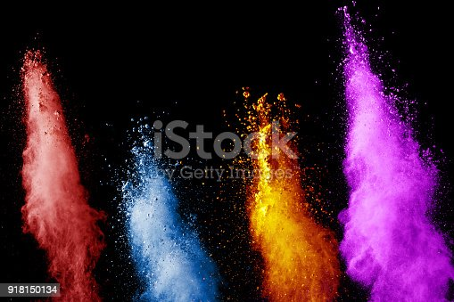 905594434istockphoto Multicolored powder explosion cloud isolated on black background. Freeze motion of color dust  particles splash 918150134