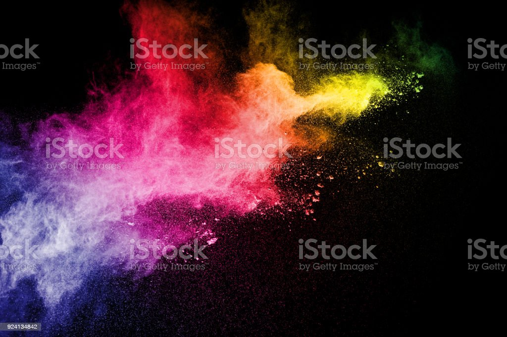 Multicolored powder explosion cloud isolated on black background. Freeze motion of color dust  particles splash. stock photo