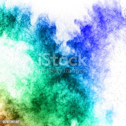 istock Multicolored powder explosion isolated on white background. Color dust splashing. 929736162