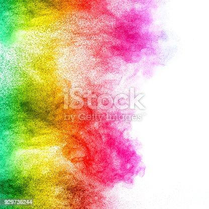 istock Multicolored powder explosion isolated on white background. Color dust splashing. 929736244