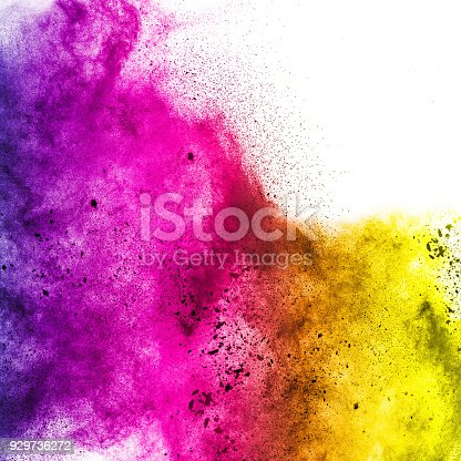918139336 istock photo Multicolored powder explosion isolated on white background. Color dust splashing. 929736272