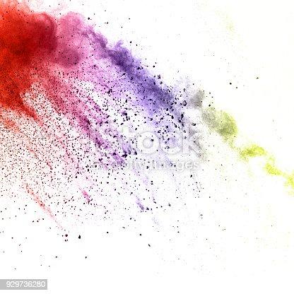 918139336istockphoto Multicolored powder explosion isolated on white background. Color dust splashing. 929736280