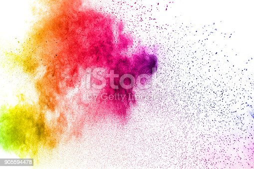 istock Multicolored powder explosion isolated on white background. Colored dust splash cloud  on white background. Launched colorful small particles on white background. 905594478