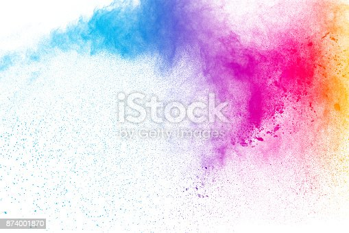 istock Multicolored powder explosion on white background. Colored powder splash cloud isolated on white background. 874001870