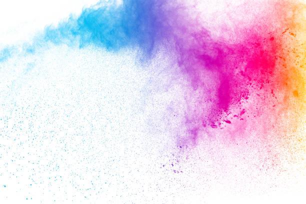 Explosion de poudre multicolore sur fond blanc. Nuage de splash de la poudre colorée isolé sur fond blanc. - Photo