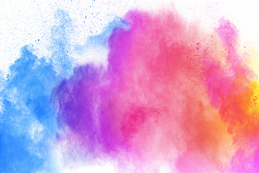istock Multicolored powder explosion on white background. Launched colourful dust particles splashing. 1134706974