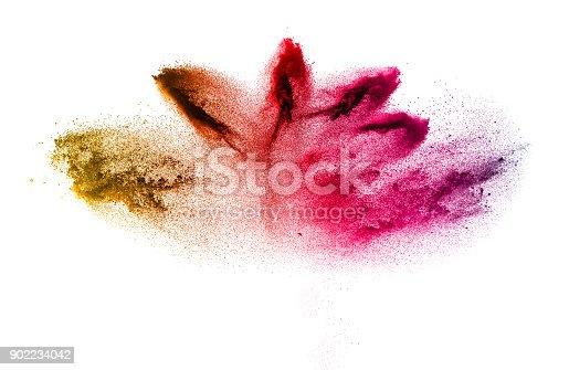 905594434istockphoto Multicolored powder explosion on white background. 902234042