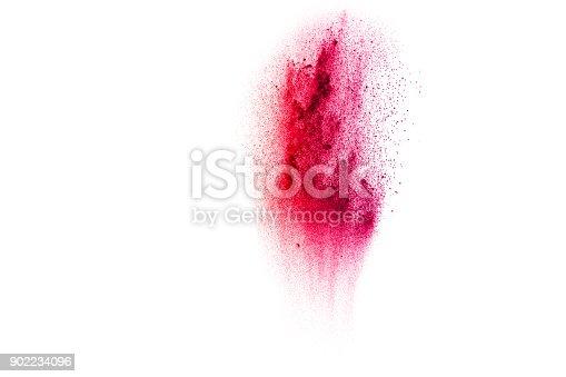 905594434istockphoto Multicolored powder explosion on white background. 902234096