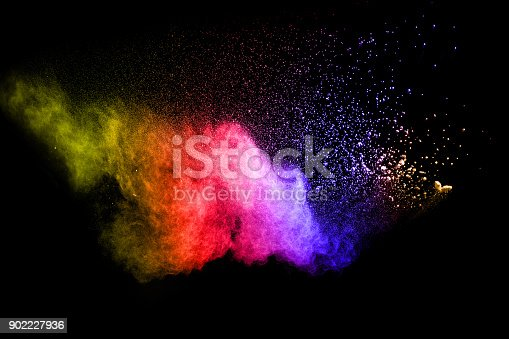 905594434 istock photo Multicolored powder splash cloud isolated on black background 902227936