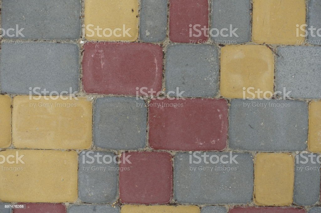 Multicolored rectangular concrete pavement blocks from above stock photo