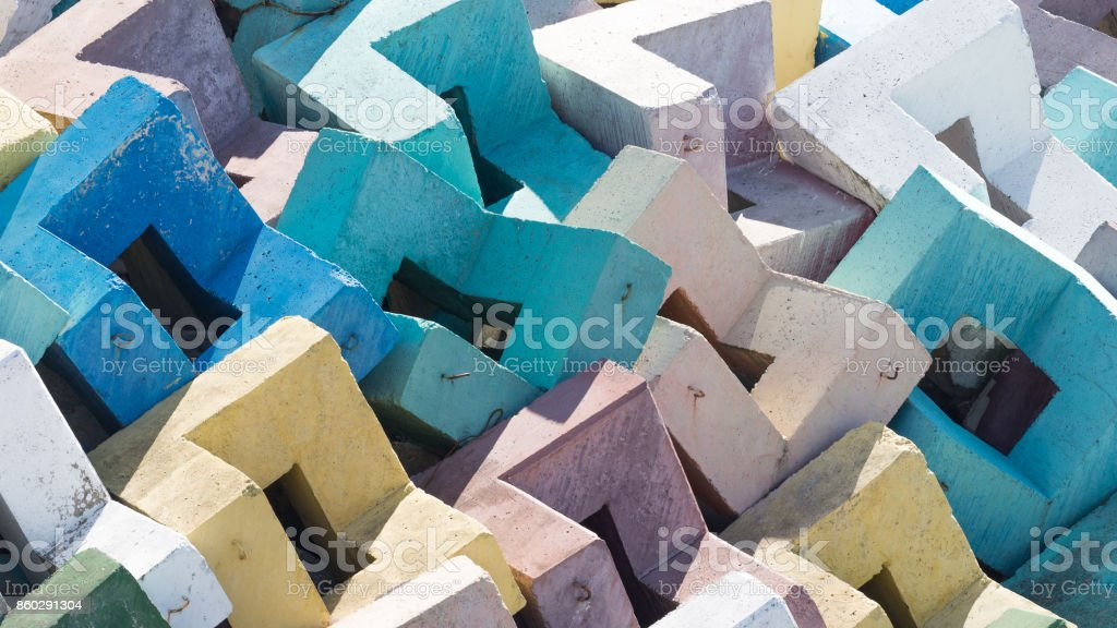 Multi-colored reinforced concrete blocks stock photo