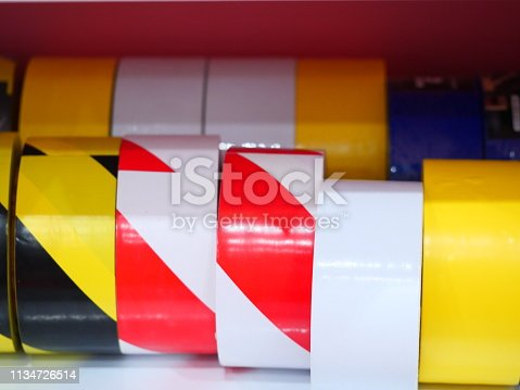 805500886 istock photo multi-colored rolls of tape on shelf 1134726514