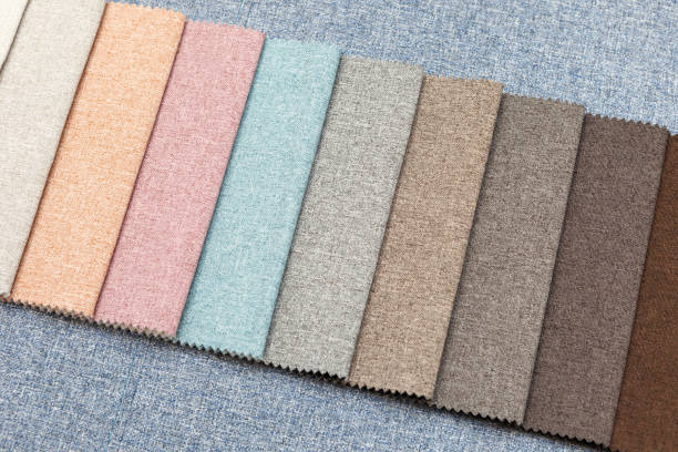 Multi-colored samples of upholstery fabric for sofas and chairs close-up. stock photo