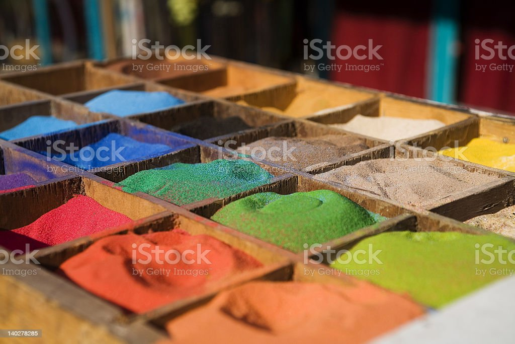 multicolored sand in the boxes stock photo