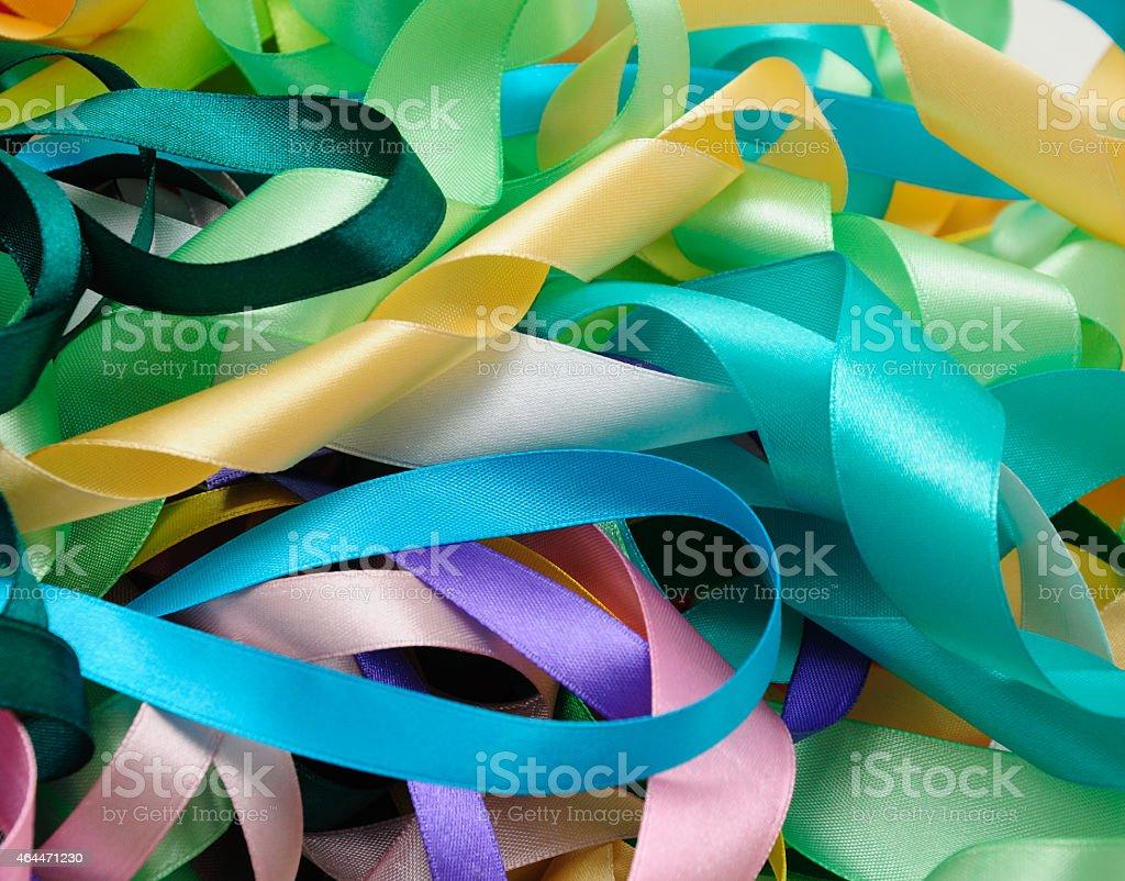 Multi-colored satin ribbons stock photo