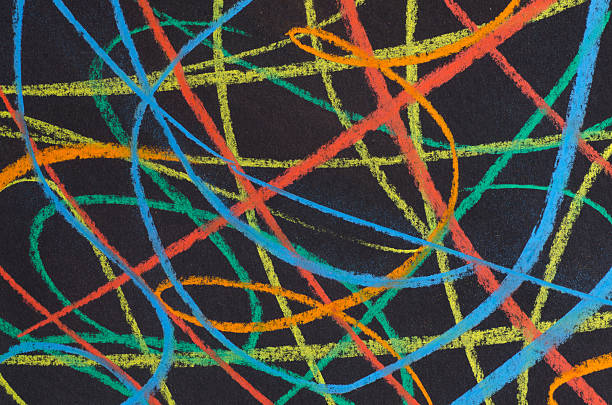 multicolored scribbles  on black background stock photo