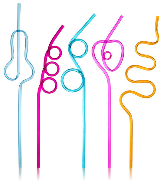 Multi-colored semi-transparent in many shapes straw. Drinking straws in the colors blue, purple, pink, yellow on a white background with slight reflection. Multi-colored semi-transparent in many shapes straw. Drinking straws in the colors blue, purple, pink, yellow on a white background with slight reflection. drinking straw stock pictures, royalty-free photos & images