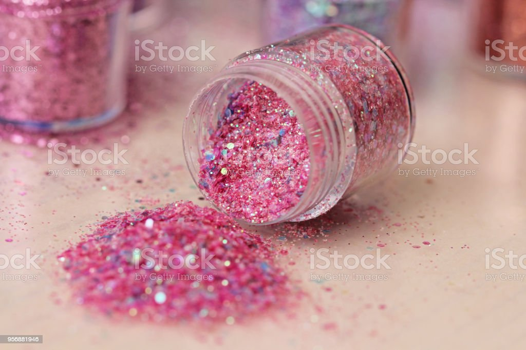 Pink Sequins for the design of nails in a box. Glitter in jars. Foil...