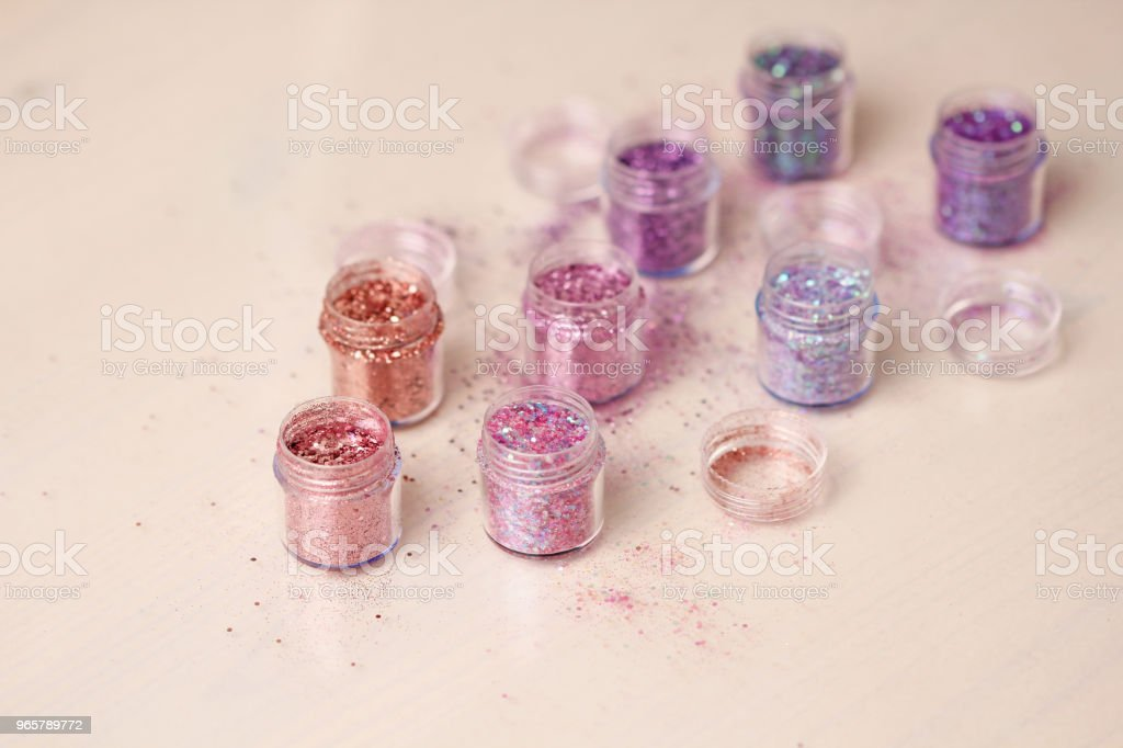 Multi-colored Sequins for the design of nails in a box. Glitter in jars. Foil for nail service. Photo set. Sparkling beauty shimmer, glitter - Royalty-free Artificial Nail Stock Photo