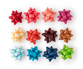 istock Multicolored shiny paper bow christmas decoration 1273295925
