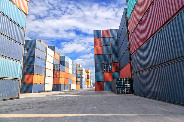 Multicolored shipping crates at the docks on a cloudy day Shipping containers at the docks le havre stock pictures, royalty-free photos & images