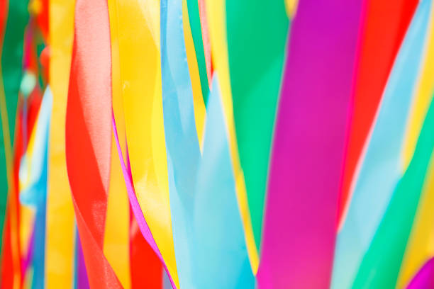 Multicolored silk ribbons are heard in the wind. Background image. Soft focus Multicolored silk ribbons are heard in the wind. Background image. Soft focus carnival celebration event stock pictures, royalty-free photos & images