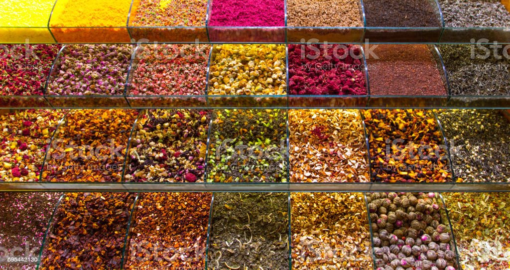 Multicolored spices, teas and nuts on the counter in the market stock photo