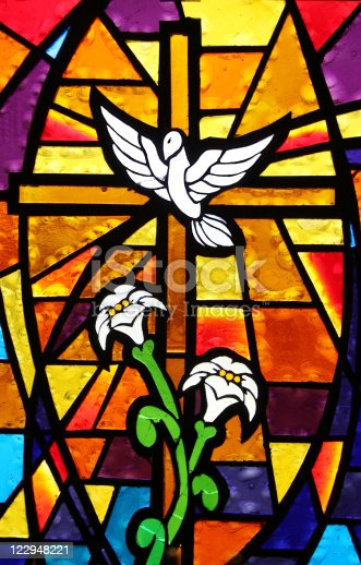 Beautiful stained glass panel found in a very old, very small church depicting the dove of peace and containing a cross and lilies.