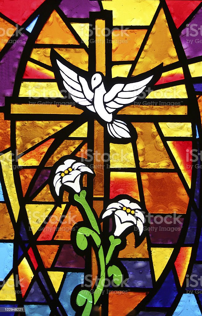 Multicolored Stained Glass Window - Cross with Dove and Lilies stock photo