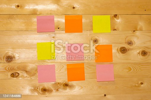 istock multicolored stickers on a wooden background. 1241184886