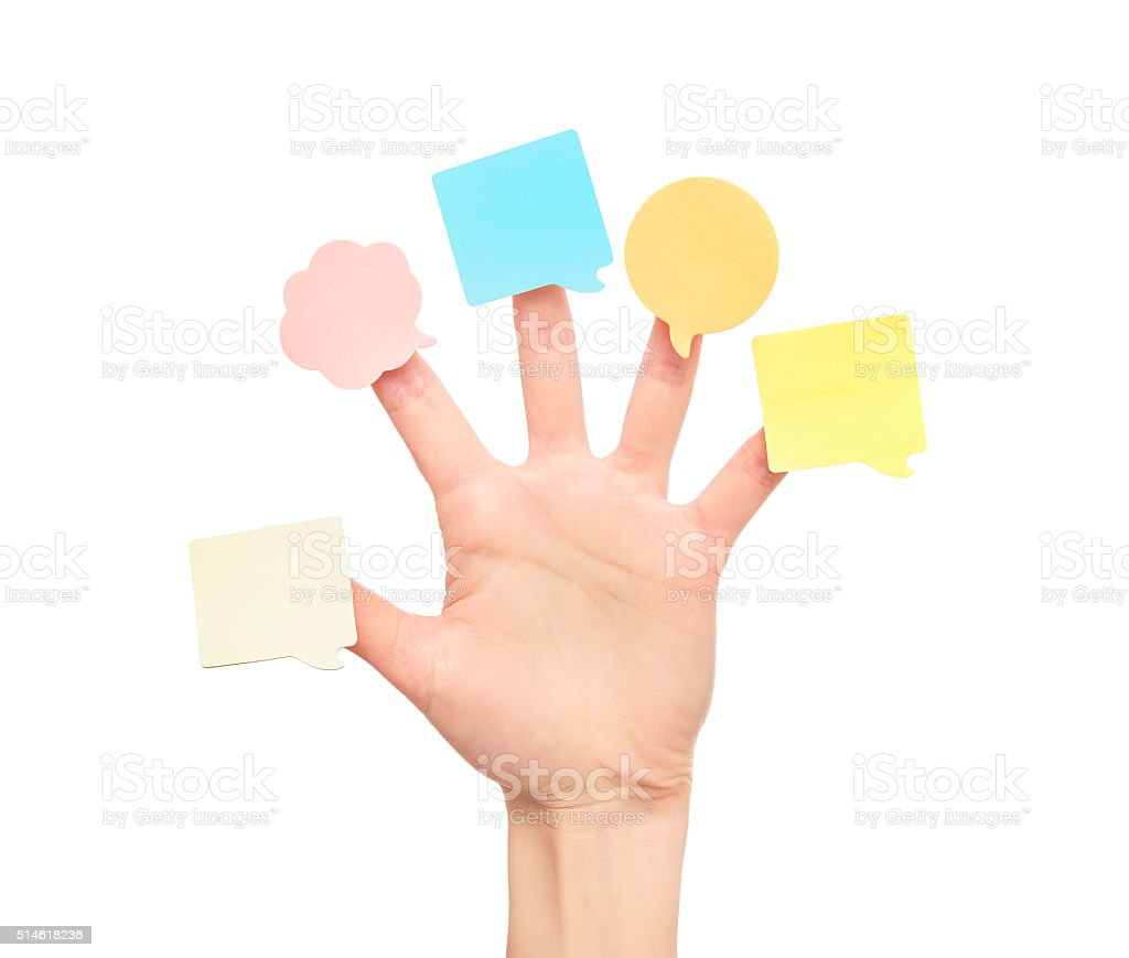 Multi-colored stickers on fingers of the hand stock photo
