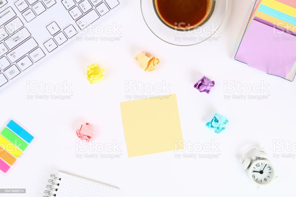 Multicolored Sticky Note Stickers On A White Desktop Next To