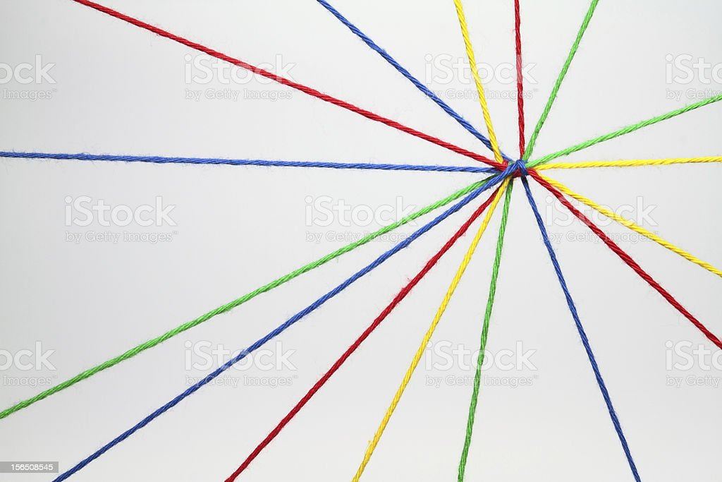 Multicolored strings tied together stock photo