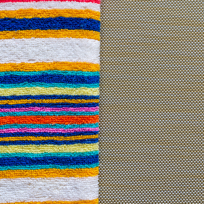 1131900491 istock photo Multi-colored striped beach towel close-up. 1251342721