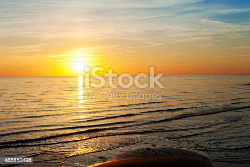 1083309578 istock photo Multicolored summertime sunset on Baltic sea. Horizontal outdoors image 485850498
